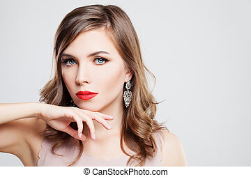 Beautiful Woman Fashion Model with Makeup and Curly Hairstyle