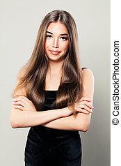Beautiful Woman Fashion Model with Natural Brown Hairstyle and Perfect Skin. Beautiful Model with Long Healthy Hair