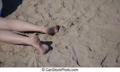 Beautiful woman feet on sand. - Beautiful woman feet on sand