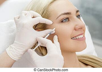 beauty facial injections - Beautiful woman gets beauty...
