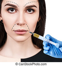 Beautiful woman gets beauty facial injections. Face aging...