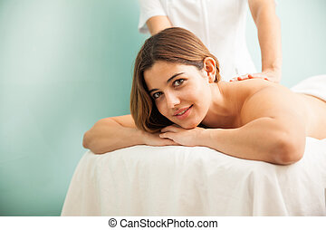 Beautiful woman getting a massage at the spa