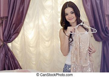 Beautiful woman getting dressed