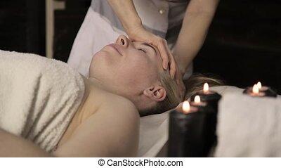 Beautiful woman getting facial massage in spa. facial skin care in beauty saloon.