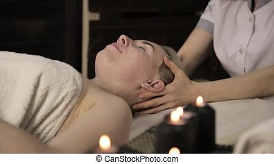 Beautiful woman getting facial massage in spa. facial skin...