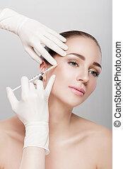 beautiful woman getting injection