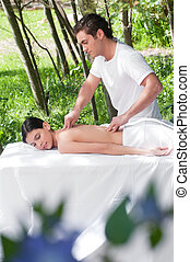 Beautiful woman getting massage from a therapist