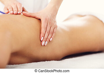 Beautiful woman getting massage in spa