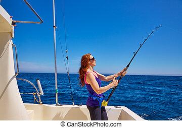 Beautiful woman girl fishing rod trolling in boat -...