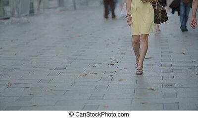 Beautiful woman going along the street