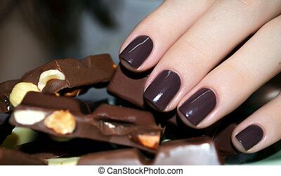 Beautiful woman hand with chokolate - Beautiful woman hand...
