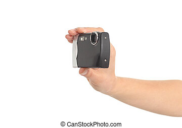 Beautiful woman hands holding a compact camera