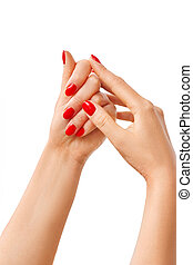 Beautiful woman hands with red manicure isolated on white background.