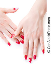 Beautiful woman hands with red nails. Isolated on white.