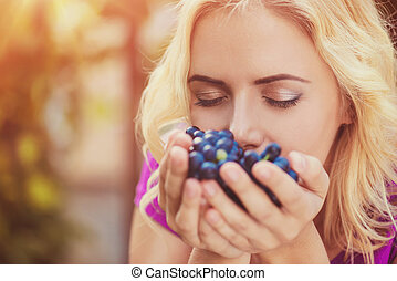 Beautiful woman harvesting grapes - Beautiful young blond...