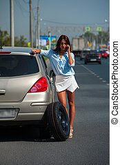 Beautiful woman has problem with the car