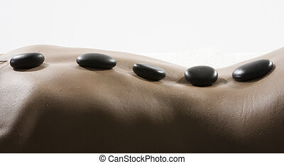beautiful woman have hotstone massage at spa and wellness center