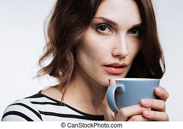 Beautiful woman having a cup of coffee