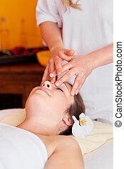 Beautiful woman having a face massage
