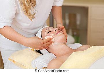 Beautiful woman having a facial in a beauty salon
