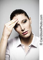 Beautiful woman having headache