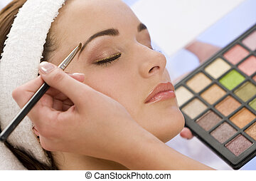 Beautiful Woman Having Make Up Applied by Beautician at Spa...