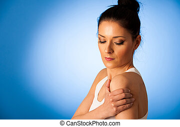 Beautiful woman having pain in her shoulder - injury