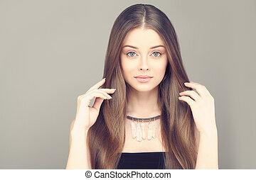 Beautiful Woman. Healthy Skin and Brown Hair.