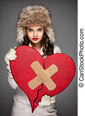 Beautiful woman hold big broken heart