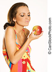 beautiful woman holding a apple