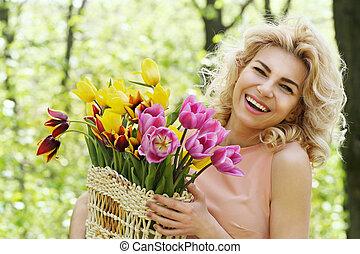 Beautiful woman holding a basket
