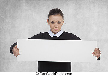Beautiful woman holding a blank billboard, copy space