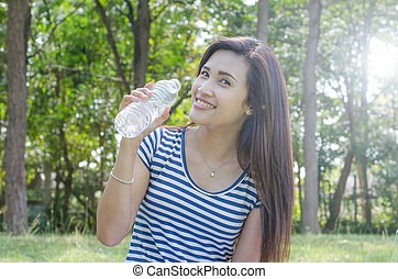 Beautiful woman holding a bottle of water