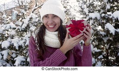 beautiful woman holding a gift