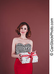 Beautiful woman holding a gift