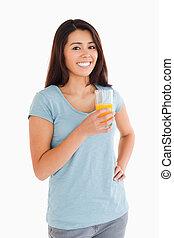Beautiful woman holding a glass of orange juice