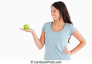 Beautiful woman holding a green apple