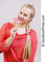beautiful woman holding a lollipop