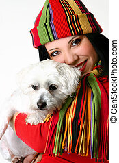 Beautiful woman holding a pet dog - A beautiful smiling...