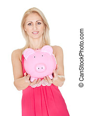Beautiful woman holding a piggybank
