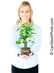 beautiful woman holding a plant