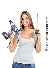 Beautiful woman holding a power drill and a tape measure ...
