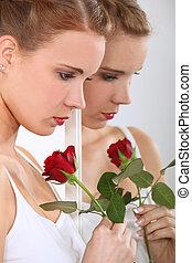Beautiful woman holding a rose