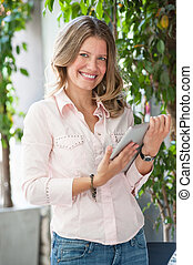 beautiful woman holding a tablet computer