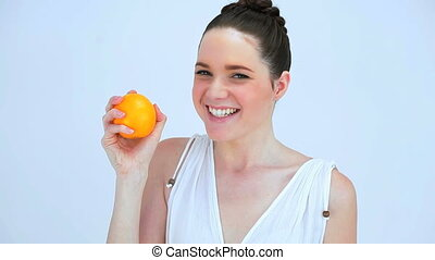 Beautiful woman holding an orange