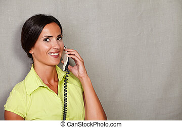 Beautiful woman holding and speaking on phone