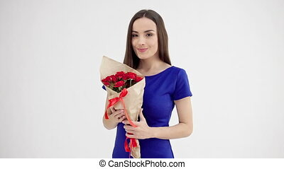 Beautiful woman holding bouquet of roses