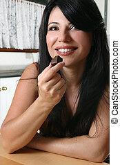 Beautiful woman holding chocolate