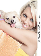 Beautiful woman holding dog in studio