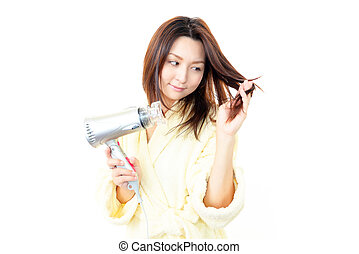 Beautiful woman holding hair dryer